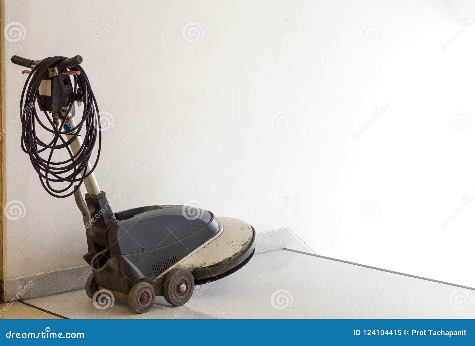 Skurborstemaskinen förläggas framme av stege- och väntanpersonallokalvården i lägenheten dörrvaktservice som är janitorial för di