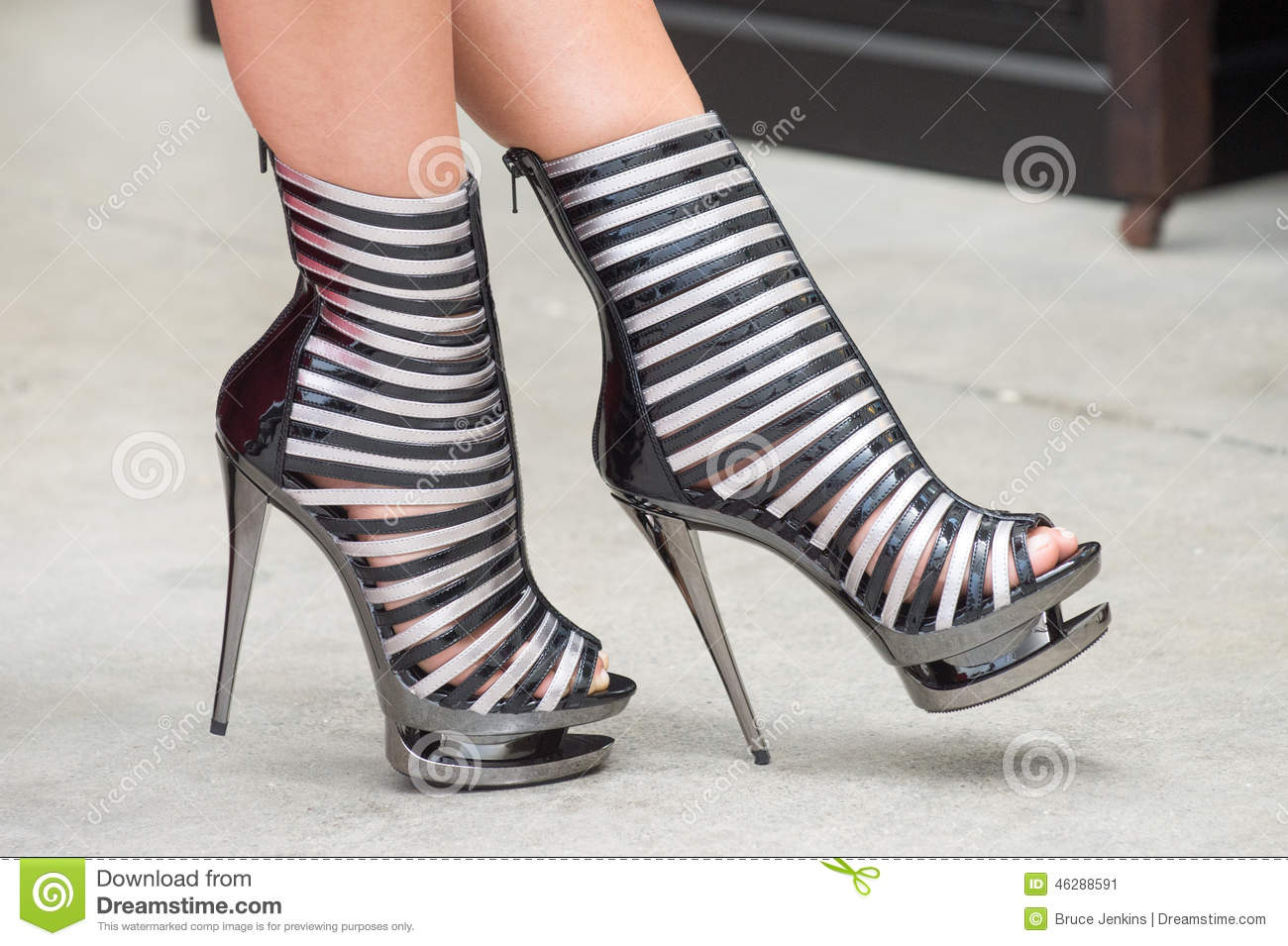 8e1dc3ce569 A model wears a pair of stiletto high heel shoes on concrete flooring