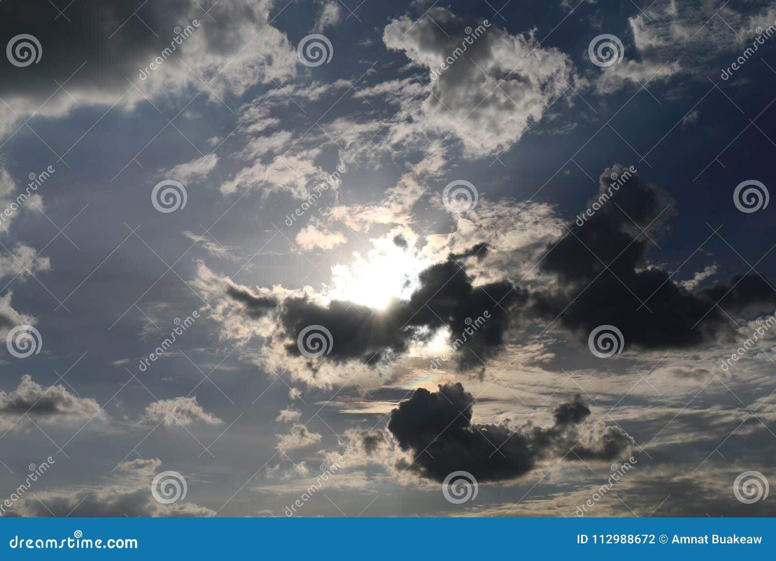 Silhouette sky sun light on dark cloud blue sky background