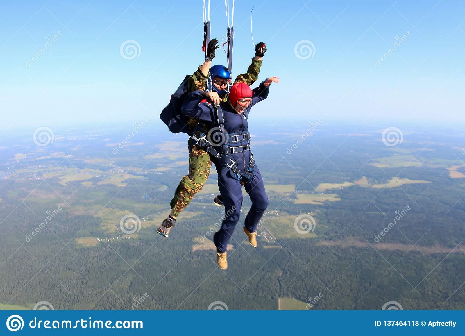 Skydiving. The moment of parachute deployment.