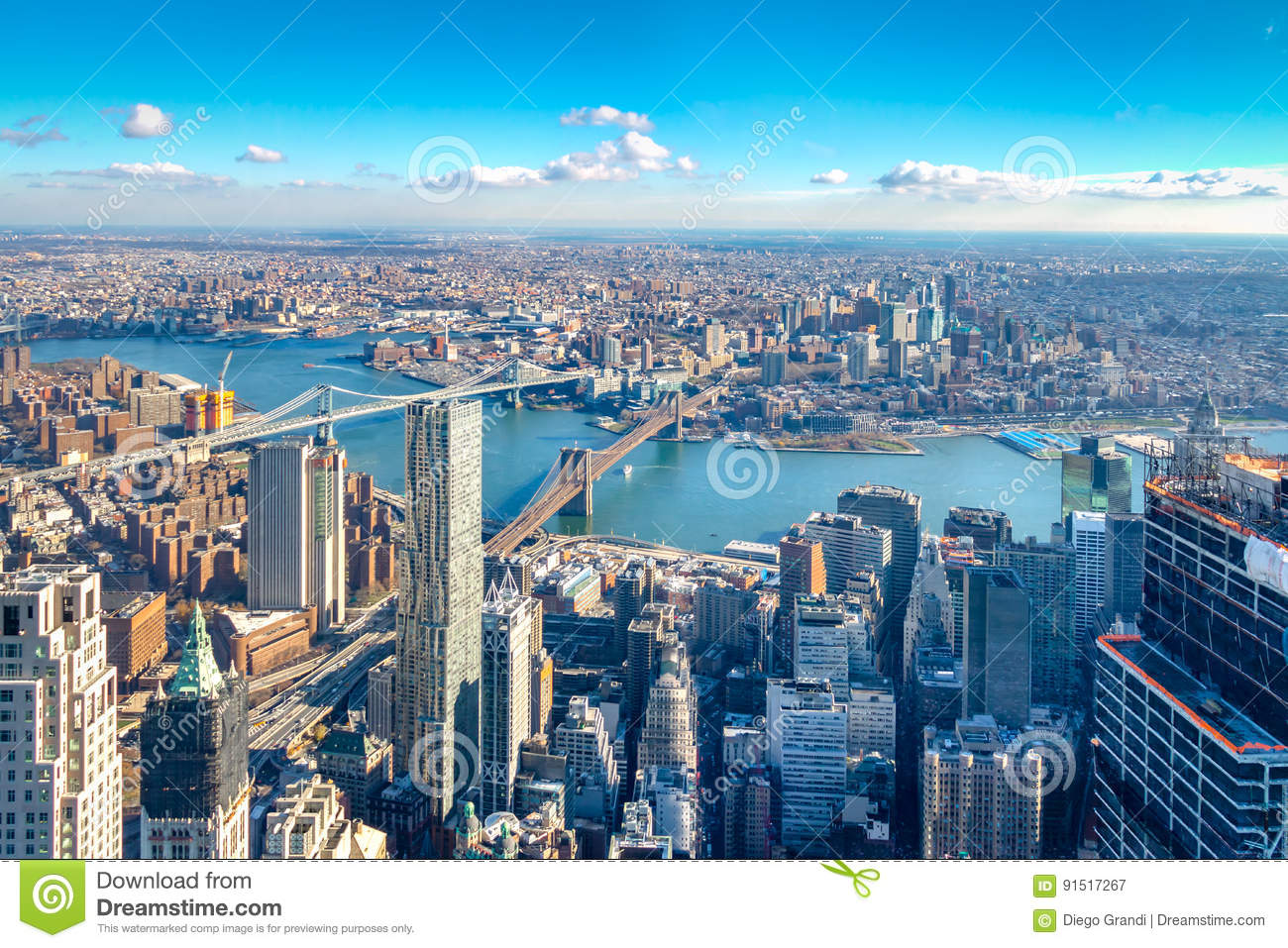 Skyline aerial view of Manhattan with skyscrapers, East River, Brooklyn Bridge and Manhattan Bridge - New York, USA