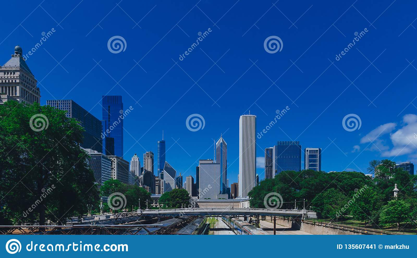 Skyline of Chicago, USA with bridge over train tracks