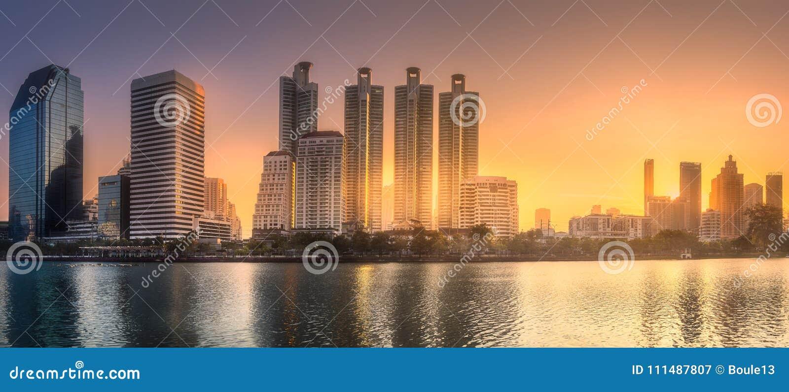 Skyline at lake in Benjakitti park Bangkok