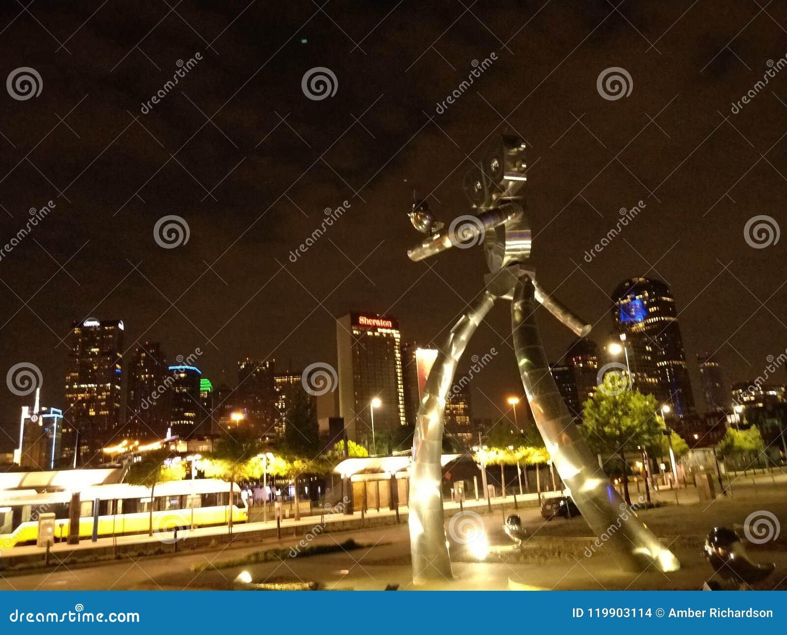Robot sculpture with Dallas, Tx skyline