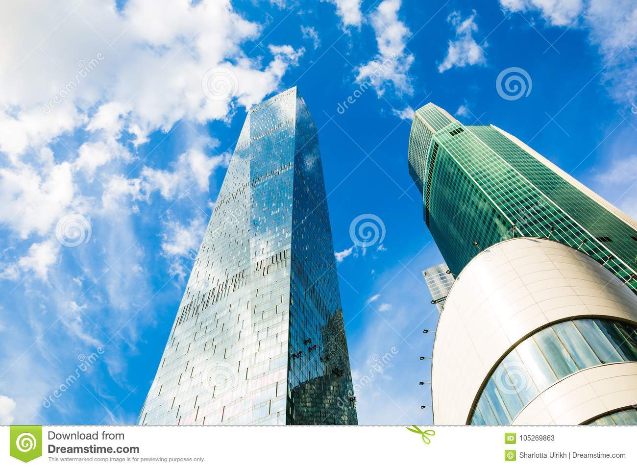Skyscraper Glass Facades On A Bright Sunny Day With Sunbeams
