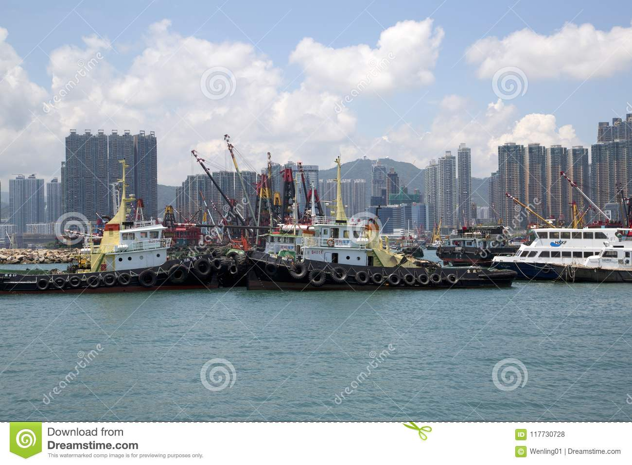 Group skyscrapers and boats in pier Hongkong