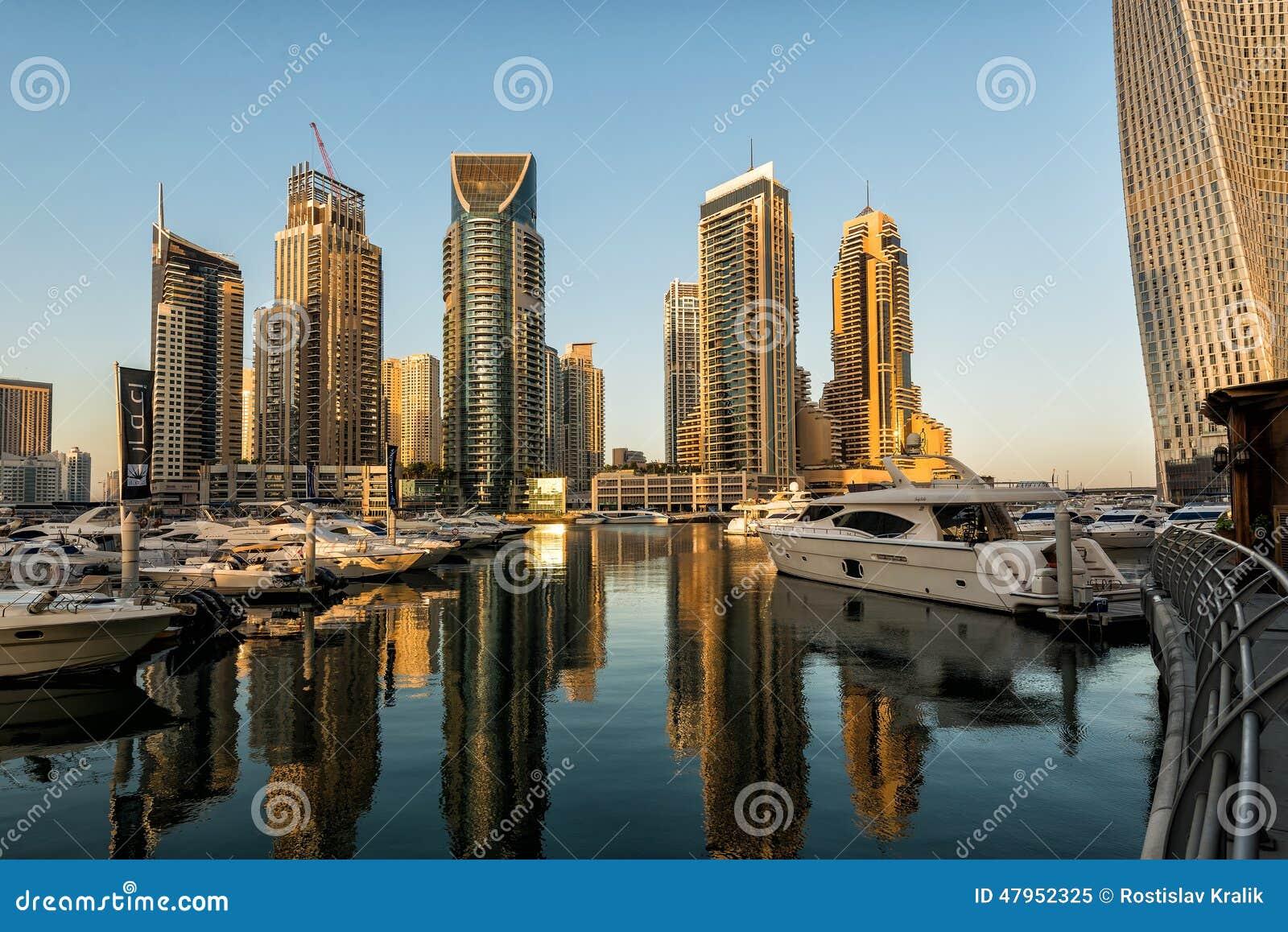 Skyscrapers in sunrise dubai marina editorial image for Luxury hotels in dubai marina