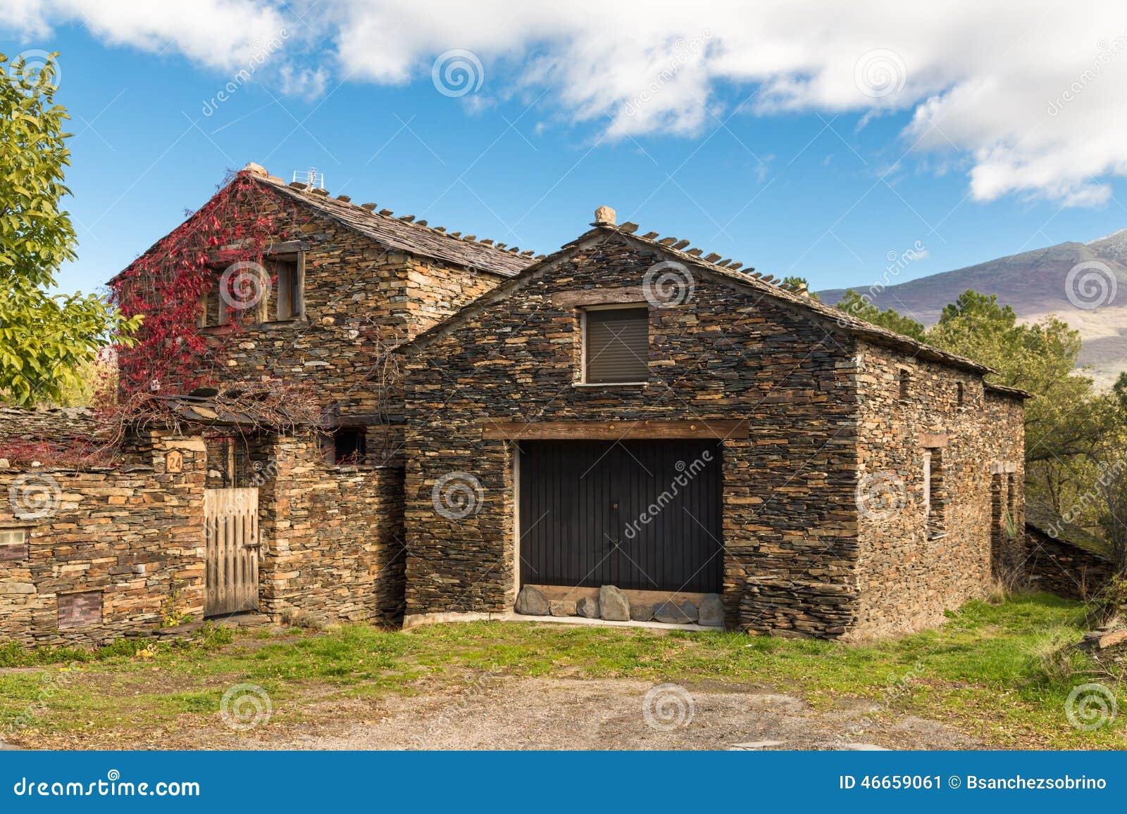 Slate stone house in guadalajara spain stock photo for Black stone house