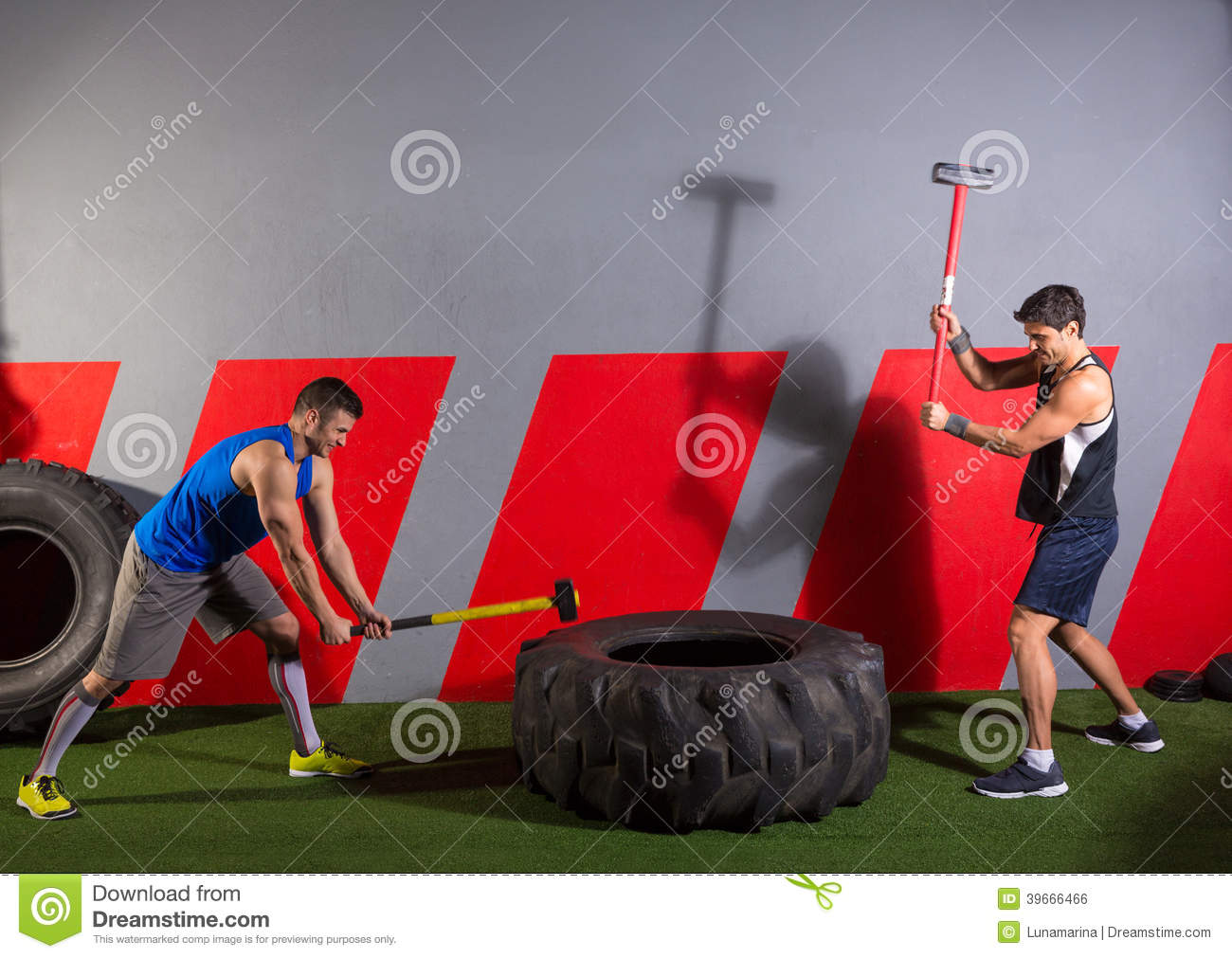 Sledgehammer Tire Hits Men Workout At Gym Stock Photo