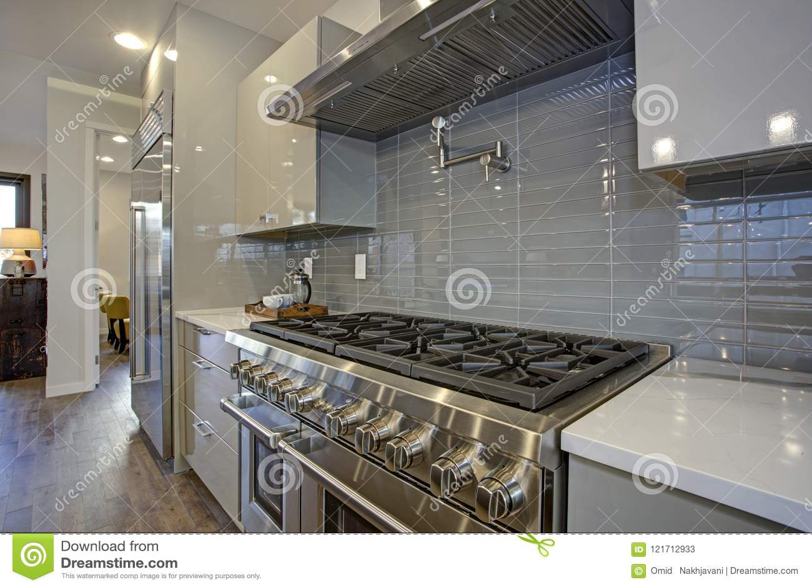 - Sleek Modern Kitchen Design With A Glossy Gray Backsplash. Stock