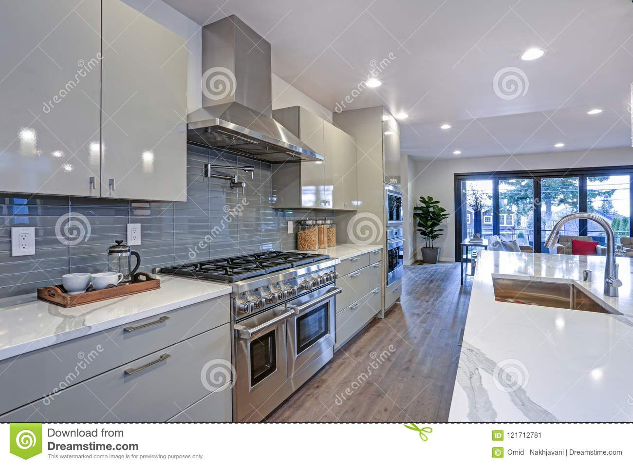 Sleek Modern Kitchen Design With An Island Stock Image
