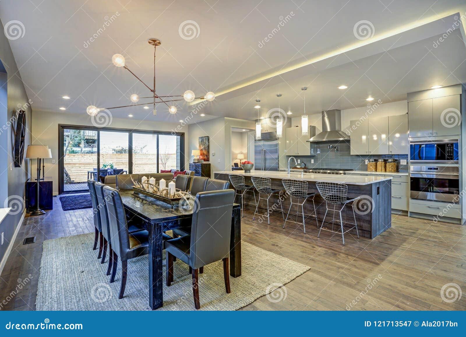 Sleek Modern Kitchen Design With A Long Center Island.