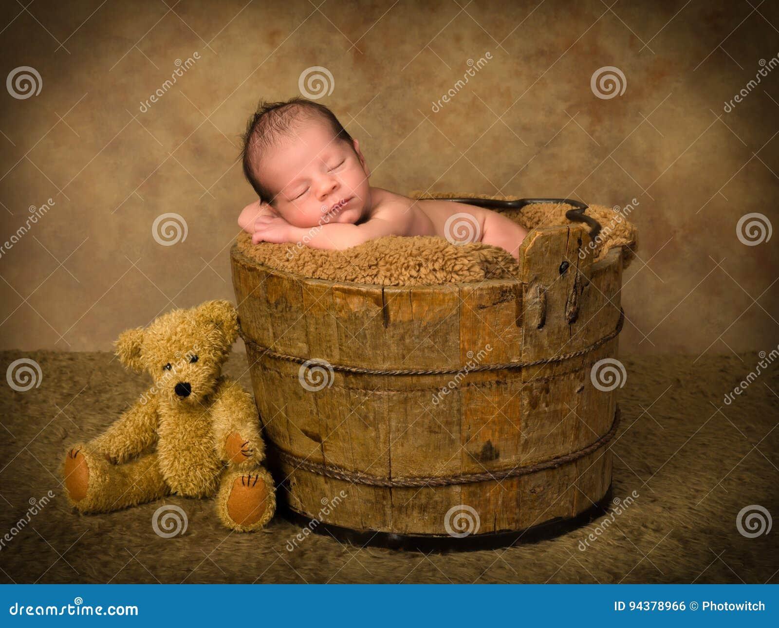 Sleeping Baby In Antique Bucket Stock Photo - Image of teddy, animal ...