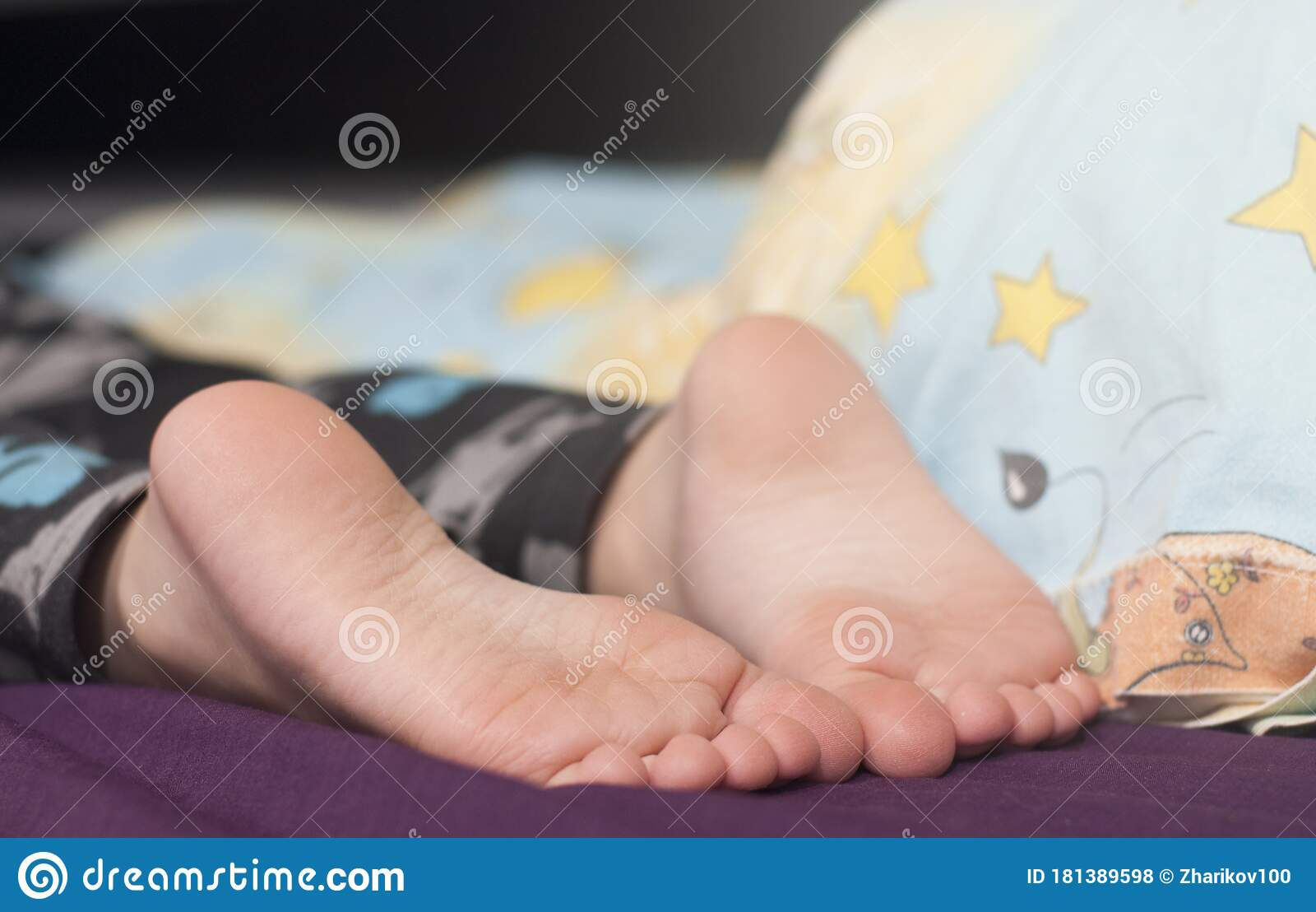 Sleeping womans feet stock image. Image of close