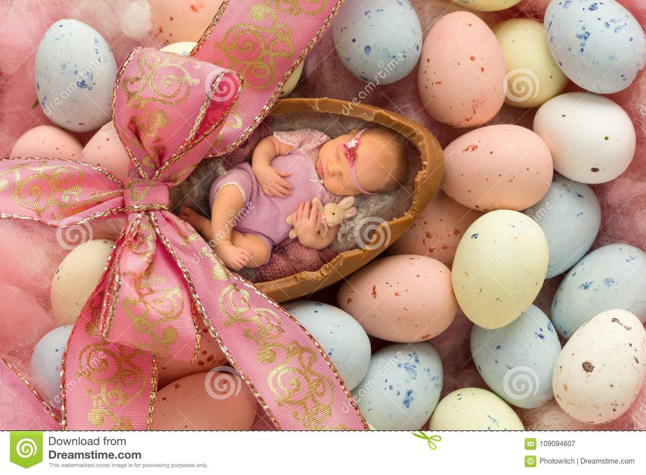 Sleeping baby in easter egg