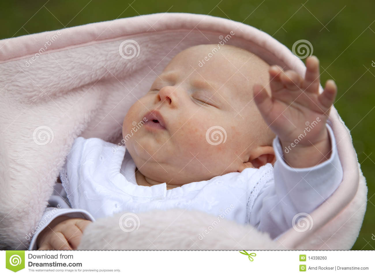 Sleeping baby girl reaching out hand stock photo image 14338260