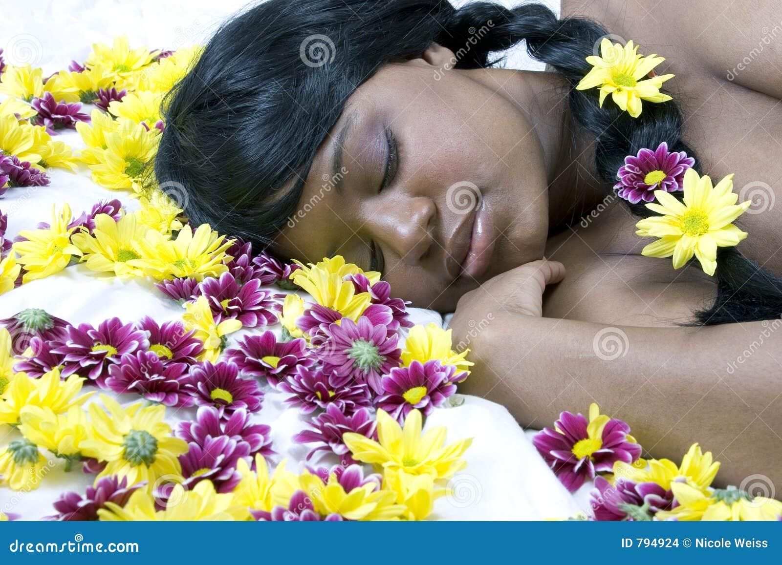 Sleeping beauty in a bed of flowers stock photo image of woman sleeping beauty in a bed of flowers izmirmasajfo