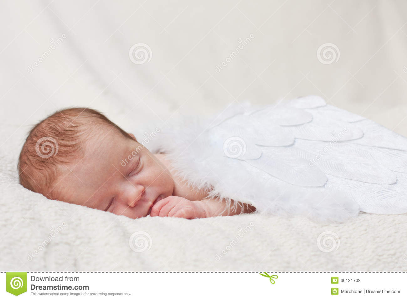Newborn Sleeping On The Wings Of Angels Royalty Free Stock ...