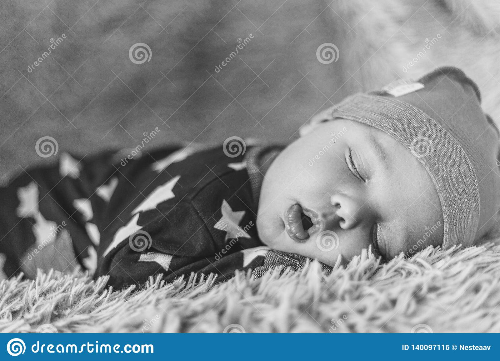 Sleeping Newborn Baby On A Blanket In Hat Black And White