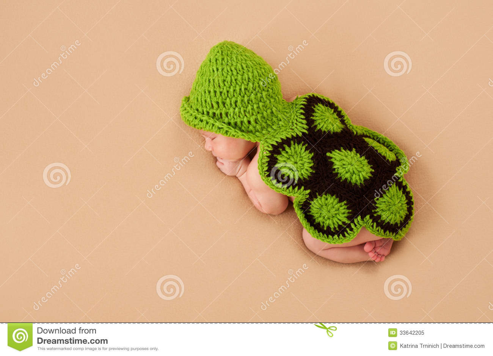 sleeping newborn baby in turtle costume royalty free stock