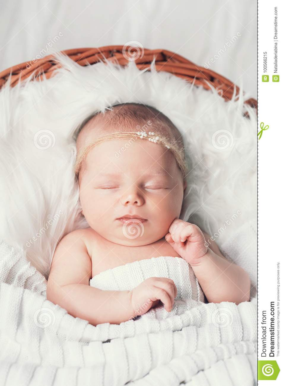 Sleeping Newborn Baby In A Wrap On White Blanket Stock Image