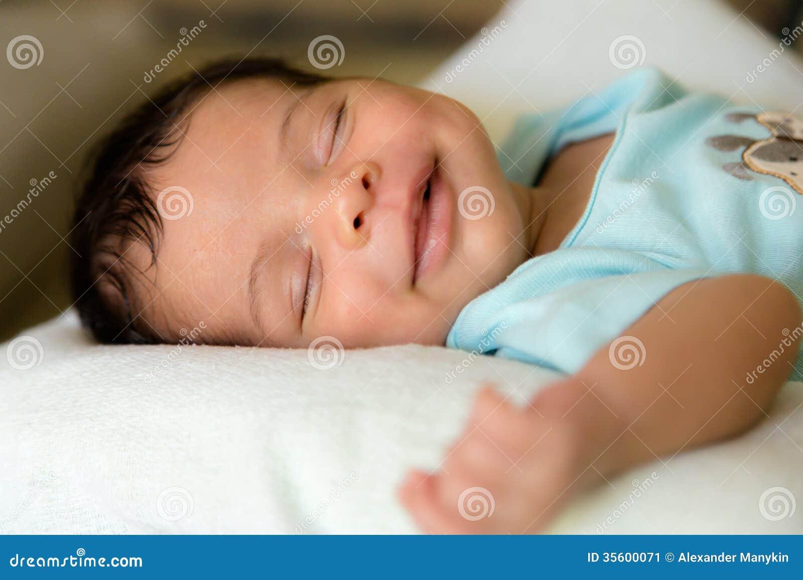 Sleeping smiling babyboy stock image image of hand life for Sleeping bed