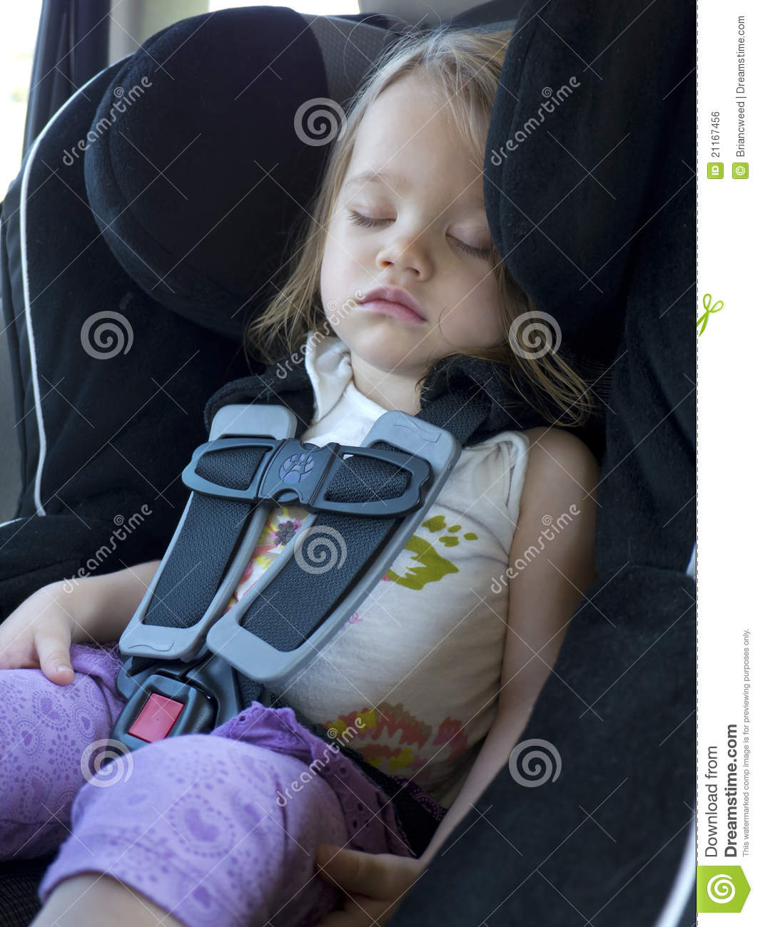 Sleeping Toddler In A Car Seat Stock Photo