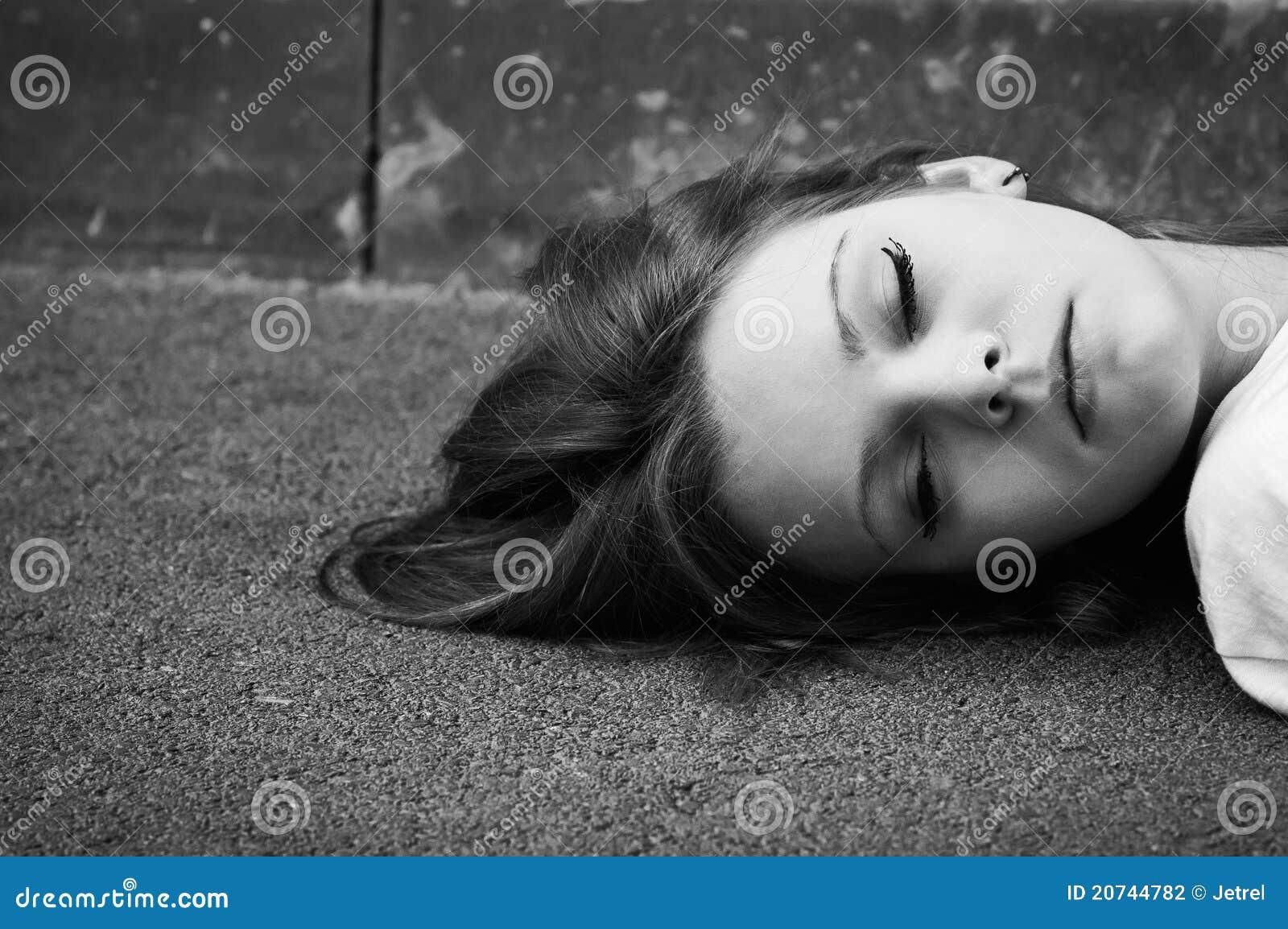 Download Sleeping Young Girl Lying On Asphalt Stock Photo - Image of model, lovely: 20744782
