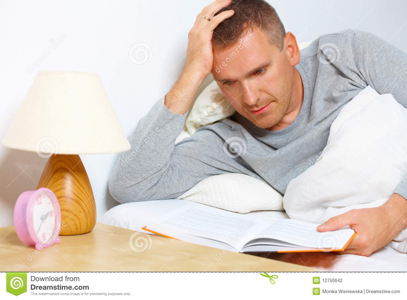 Sleepless Man Reading A Book Stock Photo - Image: 12750642