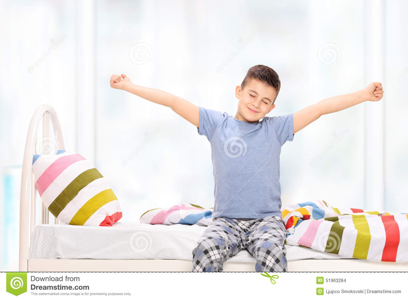 sleepy little boy in pajamas stretching himself stock photo image 51963284. Black Bedroom Furniture Sets. Home Design Ideas