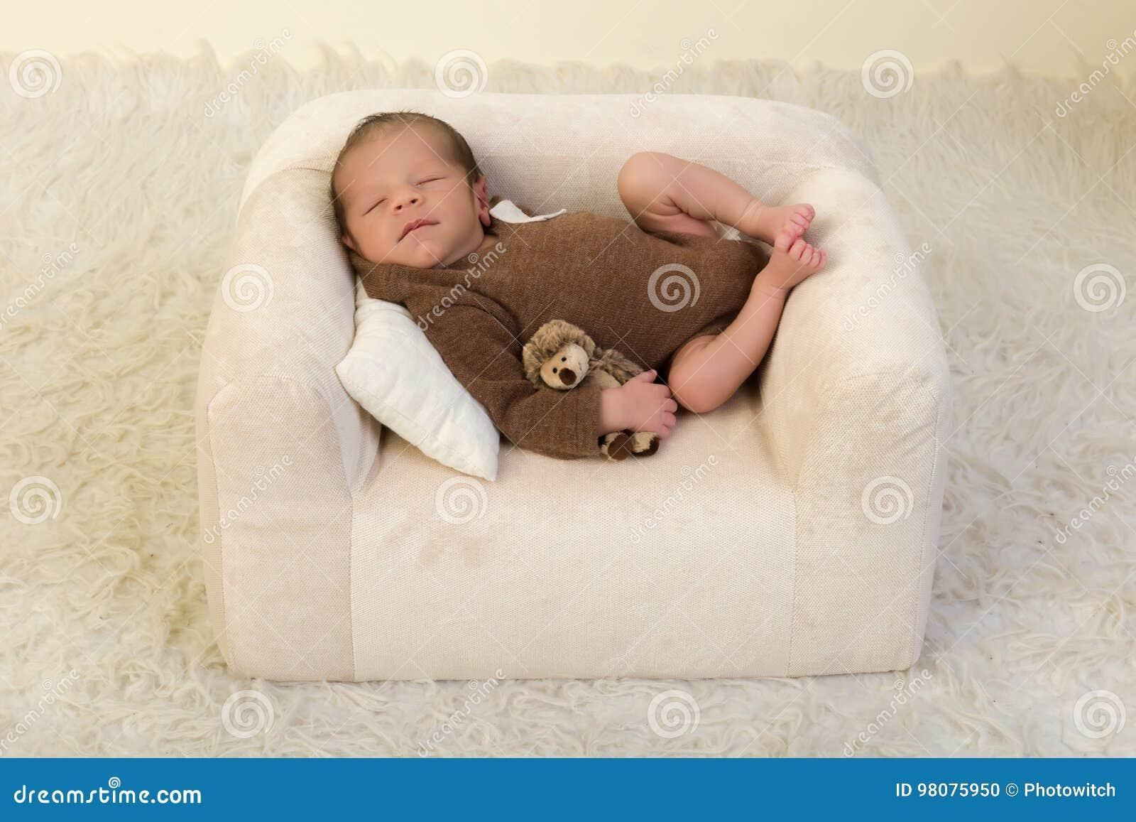 Awe Inspiring Sleepy Newborn On White Couch Stock Photo Image Of Lazy Dailytribune Chair Design For Home Dailytribuneorg