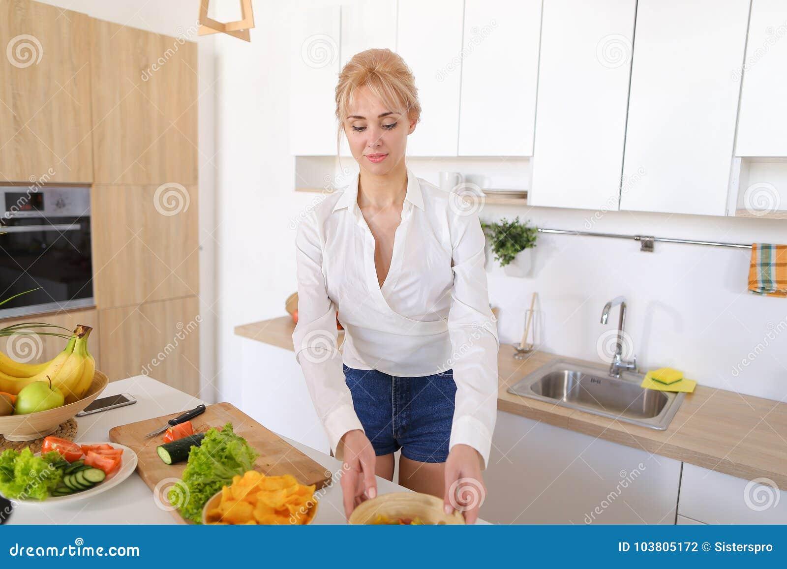 Slender Blonde Woman Completes Preparation Of Healthy Breakfast ...