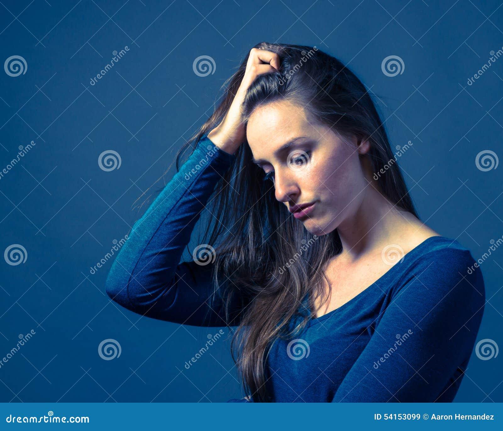 Slender Caucasian Female Somber Expression