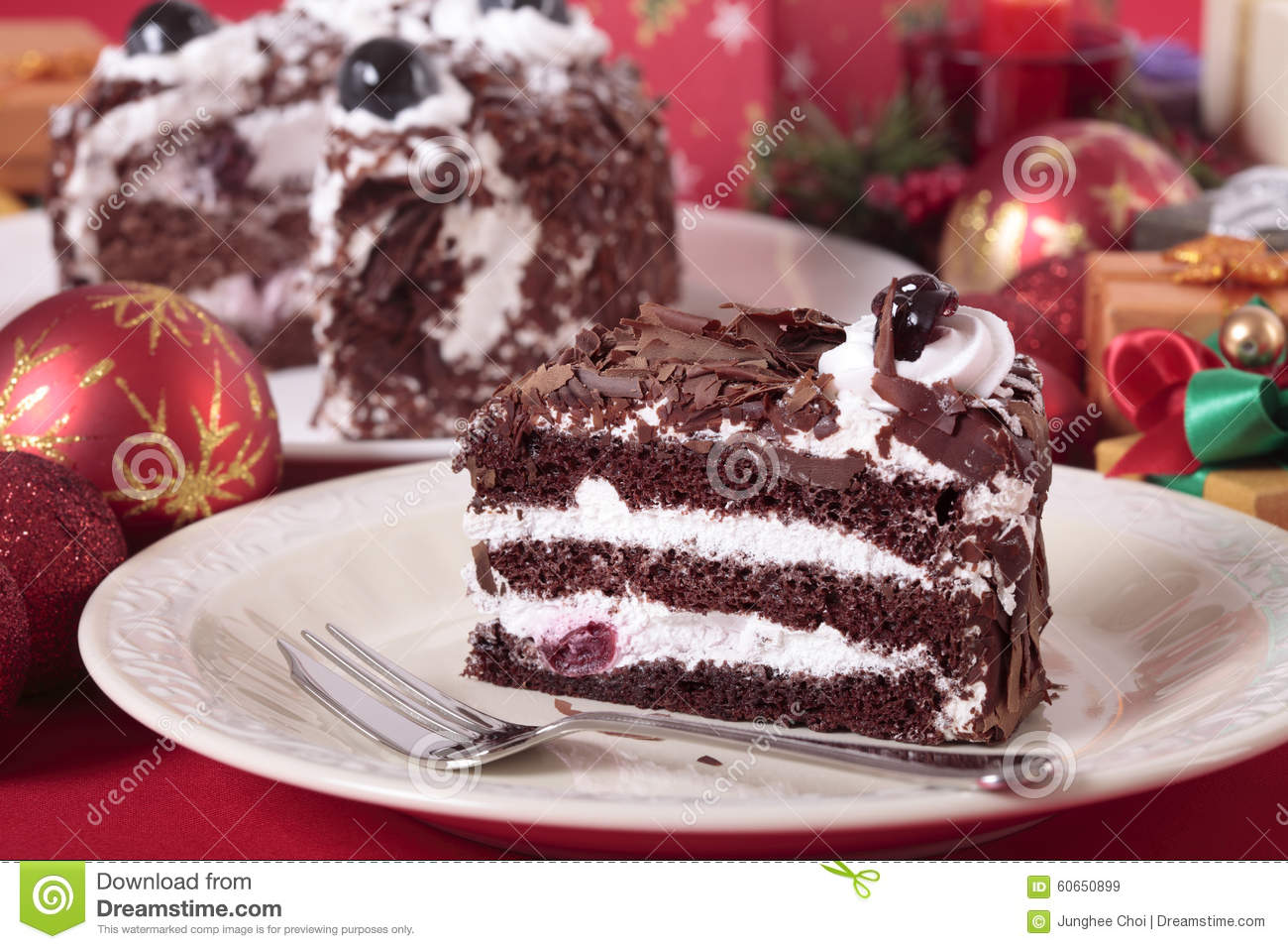 Slice Of Christmas Black Forest Gateau Cake On Plate With Decoration