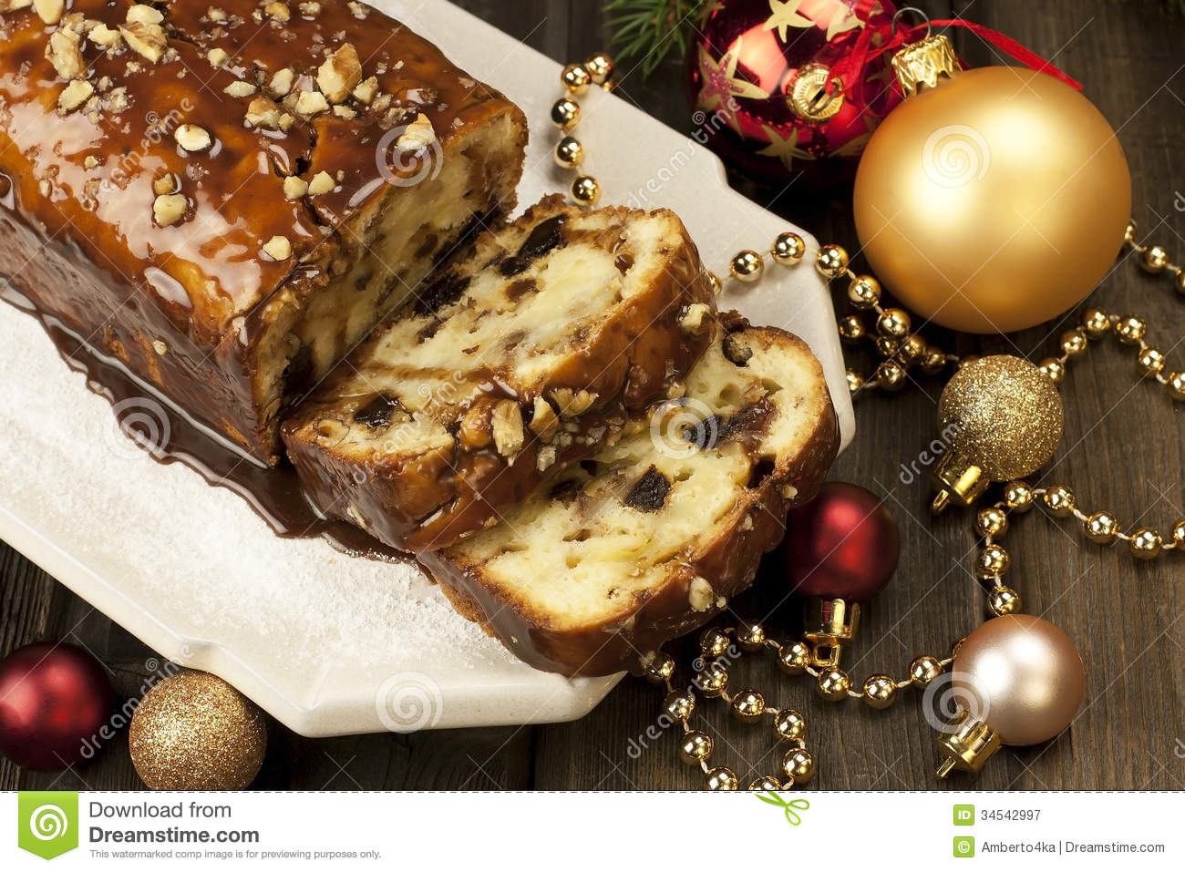 Slice of Christmas cake decorated with walnuts