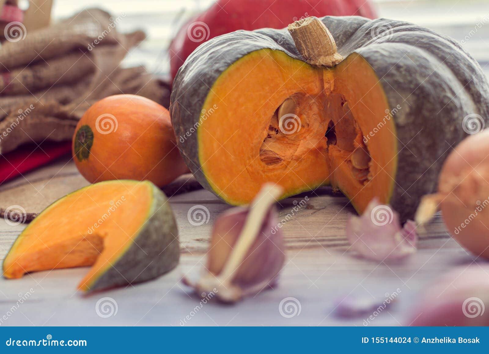 Slice of green pumpkin with garlic