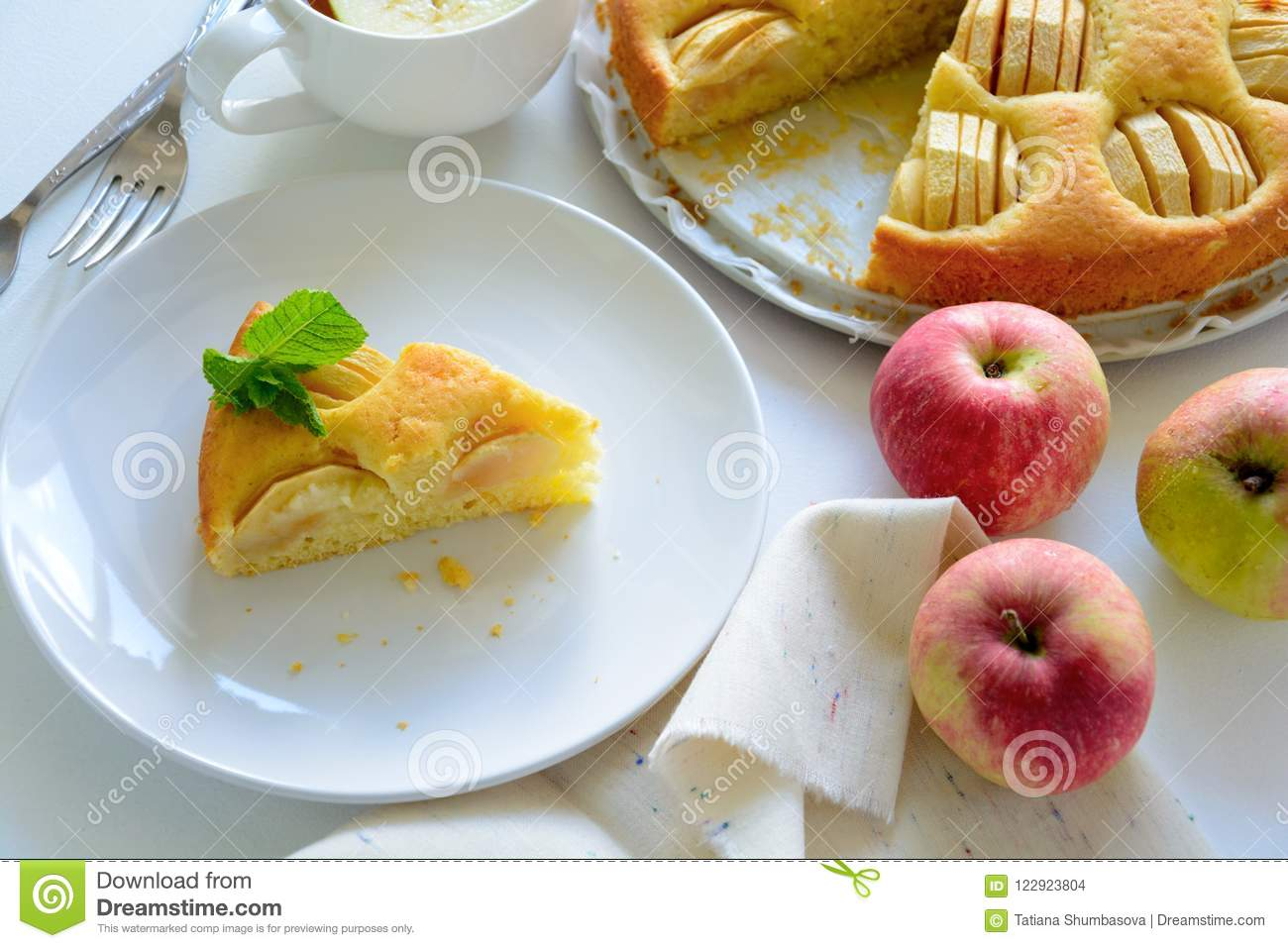 Slice of homemade apple pie on white plate. Tea time concept