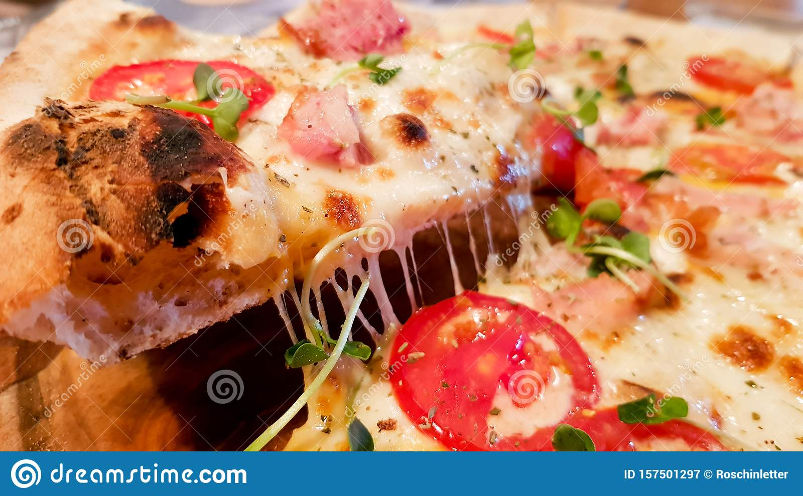 A slice of hot pizza, large cheese, lunch or dinner, seafood crust, meat sauce. with bell pepper vegetables tasty delicious fast