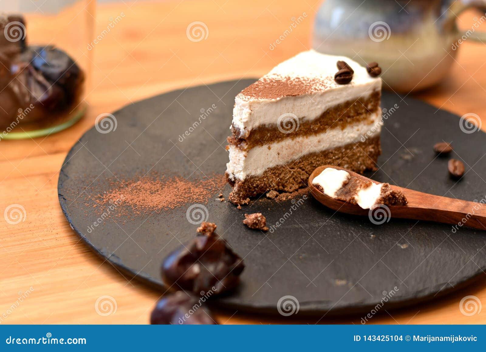 Slice of layered organic raw tiramisu cake