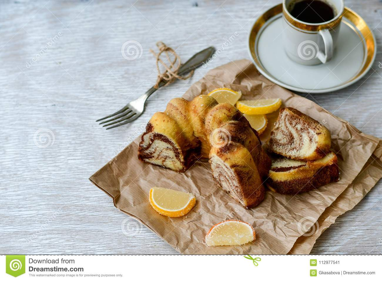 Bundt marble cake, cup of coffee and lemon slices