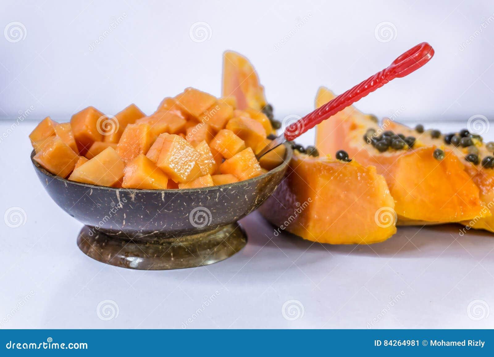 Slice of papaya isolated on the white table