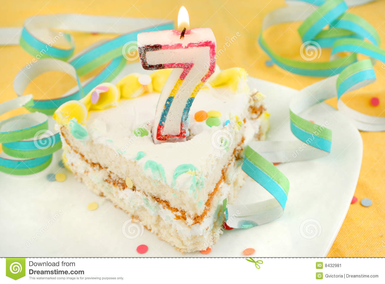 Slice Of Seventh Birthday Cake With Lit Candle Confetti And Ribbon Shallow Depth Field