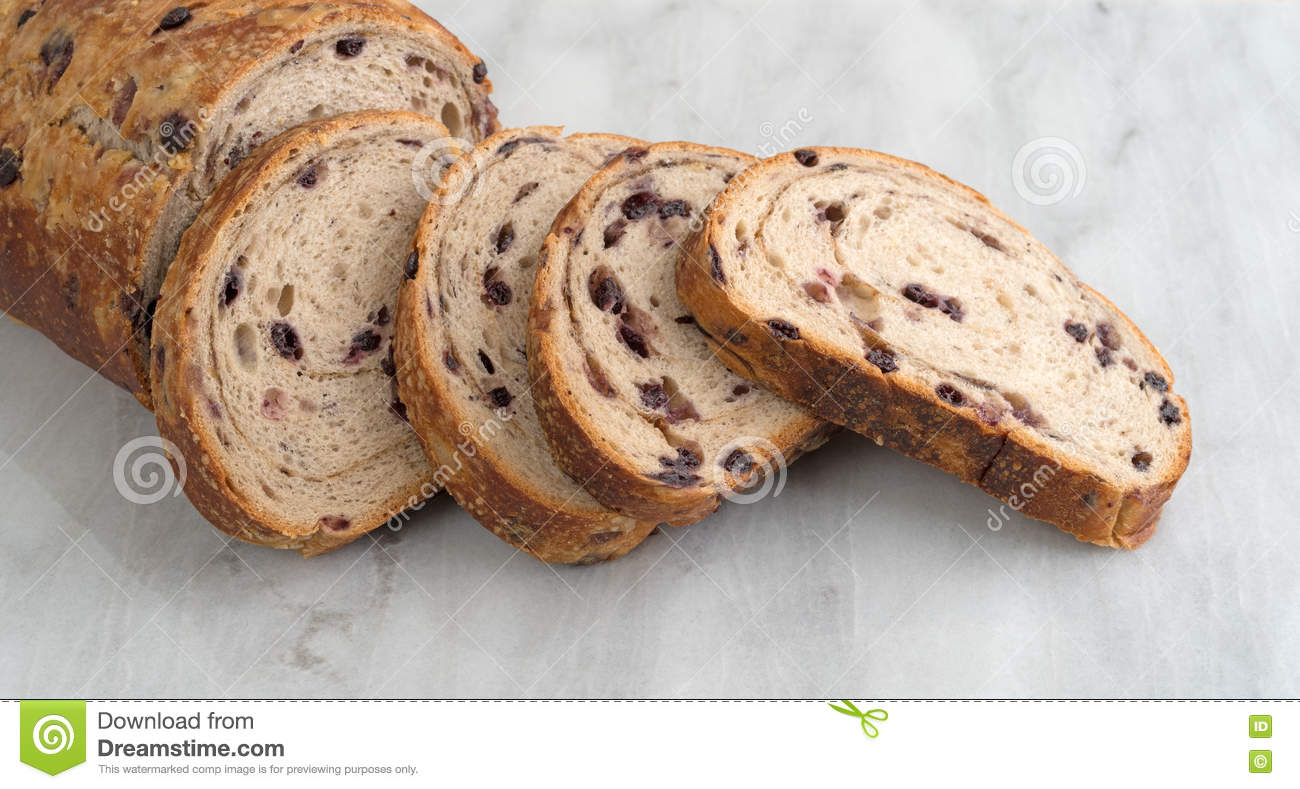 Sliced Blueberry Streusel Bread On A Marble Cutting Board