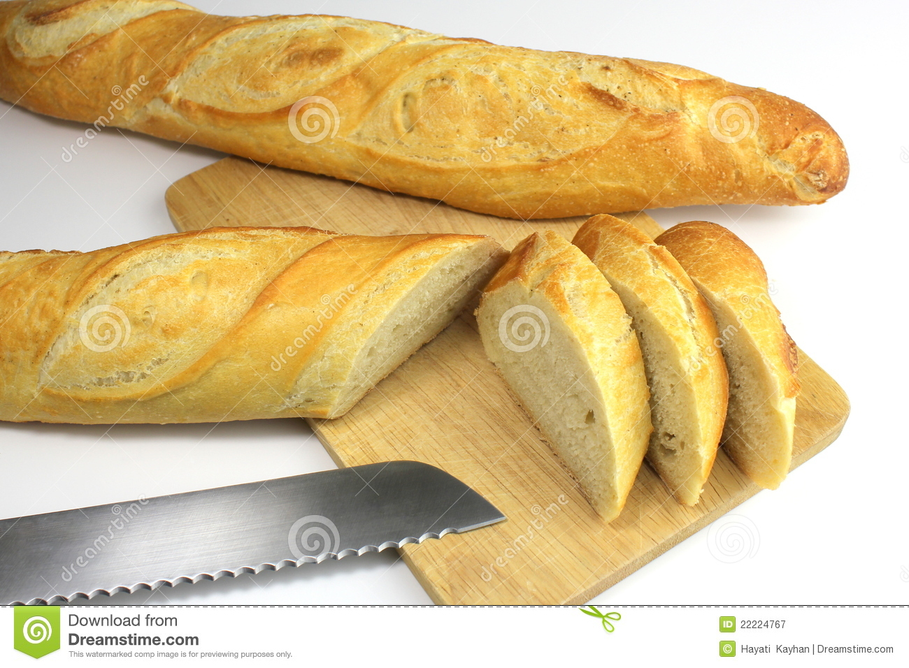 Sliced Fresh Baguette And Bread Knife Royalty Free Stock
