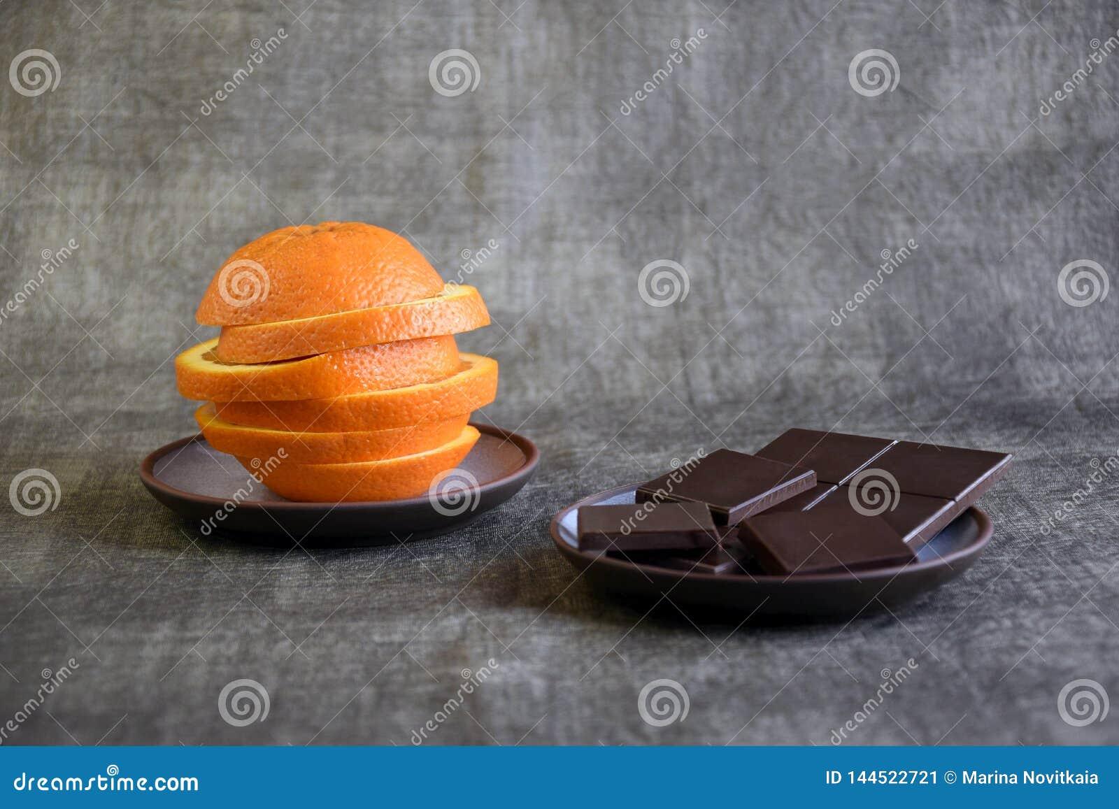 Sliced fresh orange and dark chocolate