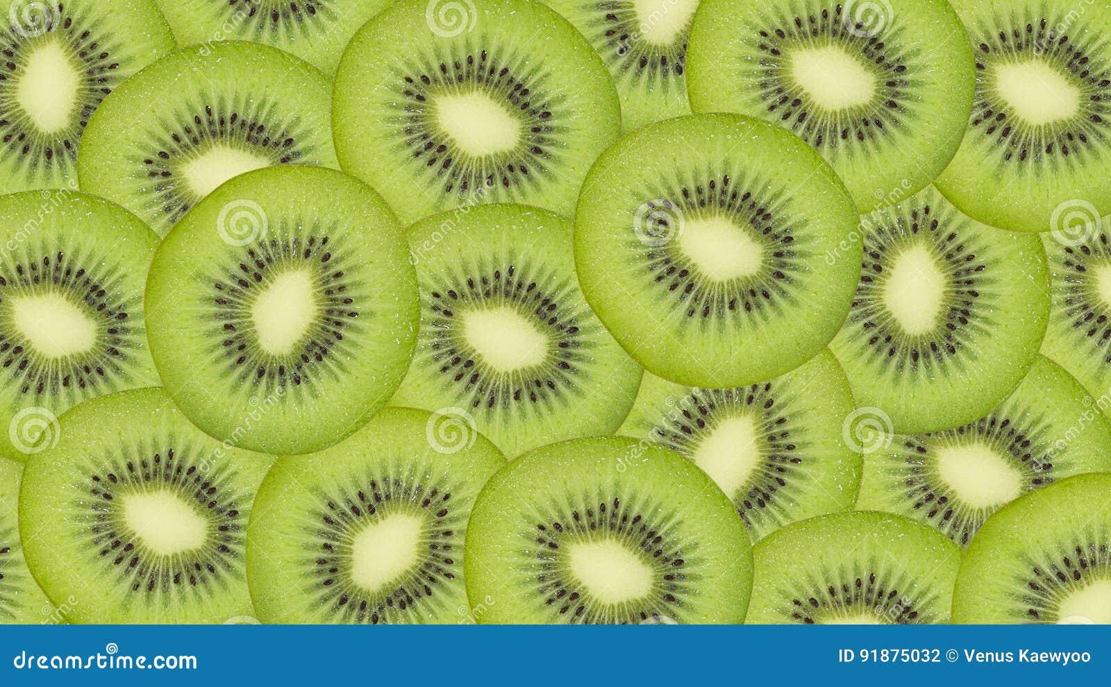 Sliced kiwi fruit pattern background