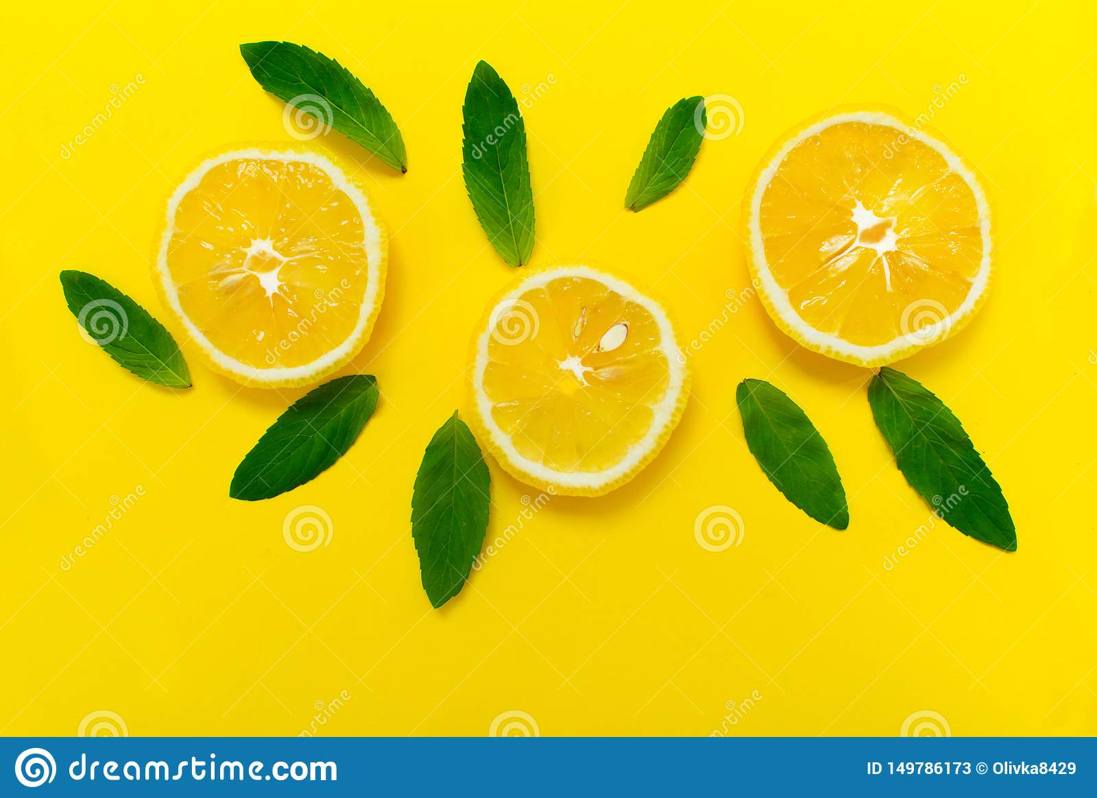 Sliced lemon and mint leaves on a bright yellow background. Background for the design of banners, websites.
