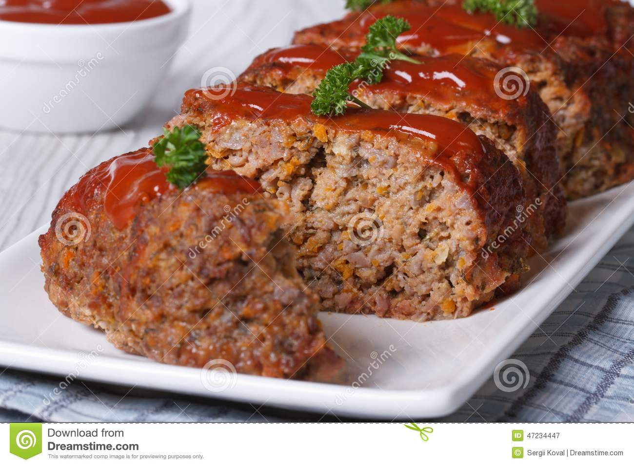 Christmas Meatloaf.Sliced Meatloaf With Ketchup And Parsley Horizontal Stock