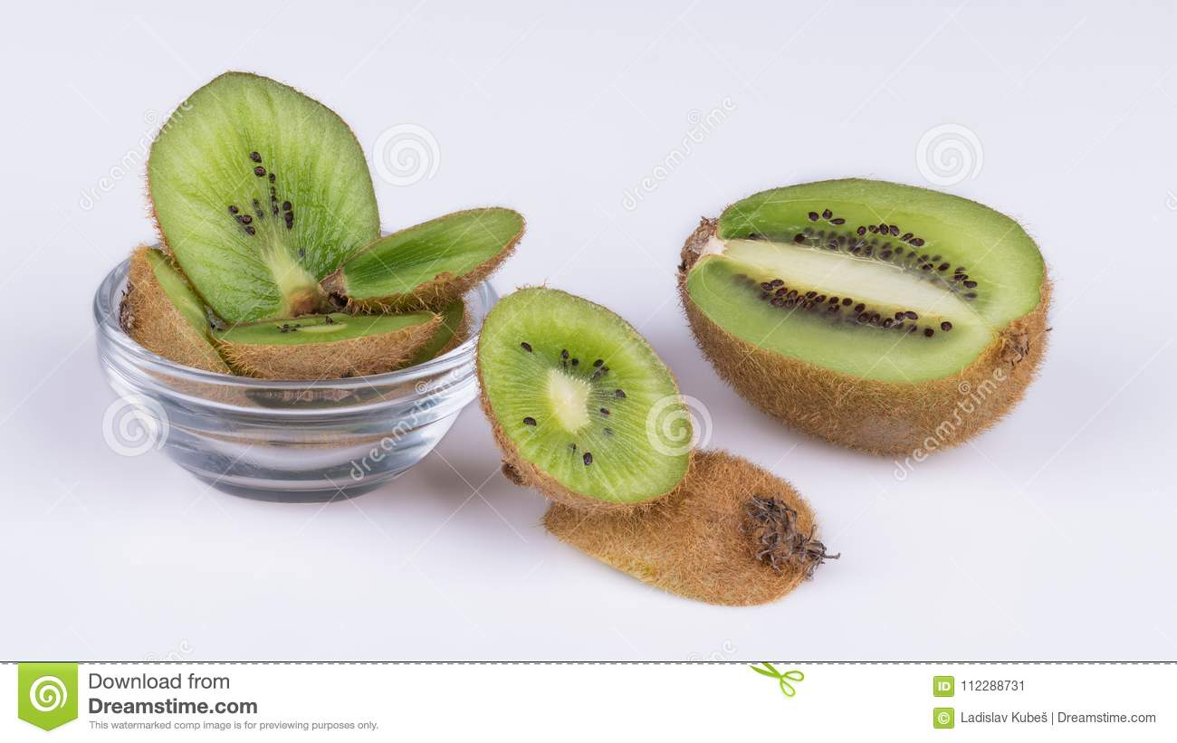 Sliced pieces of kiwis with brown skin. Actinidia deliciosa
