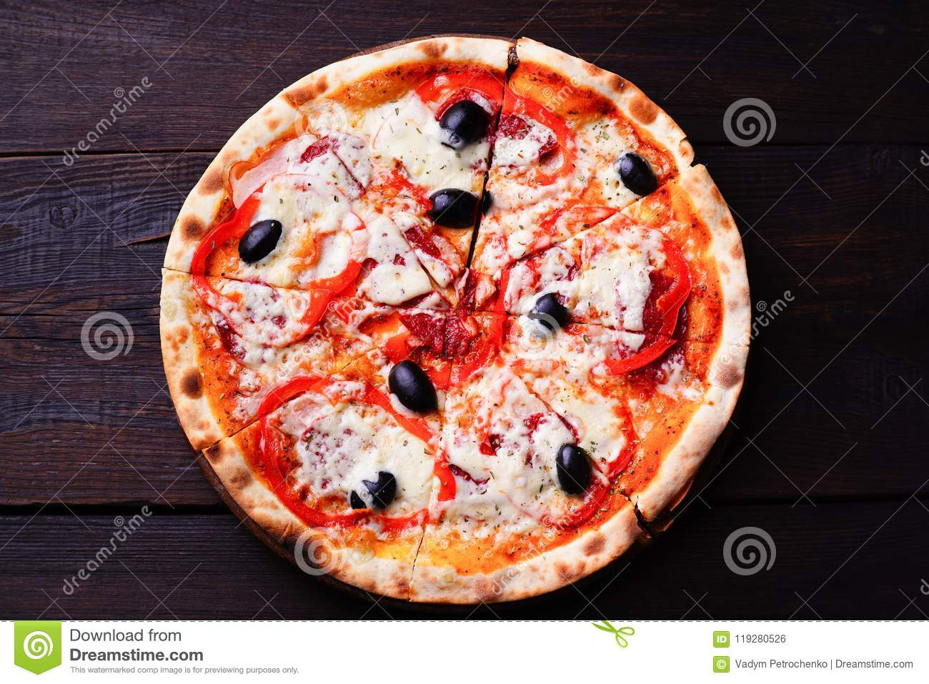 Sliced Pizza With Salami And Black Olives On Wood Stock